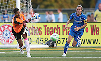 Philadelphia goalkeeper, Karina LeBlanc (23) throws the ball out to her flank midfielder as Boston captain, Kristine Lilly (13), gives chase.  Philadelphia took an early lead, but Boston stormed back with two goals to capture the win, 2-1, at Farrell Stadium in West Chester, PA.