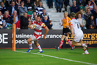 20120803 Copyright onEdition 2012©.Free for editorial use image, please credit: onEdition..Gareth Evans of Gloucester Rugby scores a try against Saracens 7s at The Recreation Ground, Bath in the Final round of The J.P. Morgan Asset Management Premiership Rugby 7s Series...The J.P. Morgan Asset Management Premiership Rugby 7s Series kicked off again for the third season on Friday 13th July at The Stoop, Twickenham with Pool B being played at Edgeley Park, Stockport on Friday, 20th July, Pool C at Kingsholm Gloucester on Thursday, 26th July and the Final being played at The Recreation Ground, Bath on Friday 3rd August. The innovative tournament, which involves all 12 Premiership Rugby clubs, offers a fantastic platform for some of the country's finest young athletes to be exposed to the excitement, pressures and skills required to compete at an elite level...The 12 Premiership Rugby clubs are divided into three groups for the tournament, with the winner and runner up of each regional event going through to the Final. There are six games each evening, with each match consisting of two 7 minute halves with a 2 minute break at half time...For additional images please go to: http://www.w-w-i.com/jp_morgan_premiership_sevens/..For press contacts contact: Beth Begg at brandRapport on D: +44 (0)20 7932 5813 M: +44 (0)7900 88231 E: BBegg@brand-rapport.com..If you require a higher resolution image or you have any other onEdition photographic enquiries, please contact onEdition on 0845 900 2 900 or email info@onEdition.com.This image is copyright the onEdition 2012©..This image has been supplied by onEdition and must be credited onEdition. The author is asserting his full Moral rights in relation to the publication of this image. Rights for onward transmission of any image or file is not granted or implied. Changing or deleting Copyright information is illegal as specified in the Copyright, Design and Patents Act 1988. If you are in any way unsure of your right to publish this