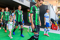 AUSTIN, TX - JUNE 19: Matt Besler #5 of Austin FC and daughter enter the pitch before a game between San Jose Earthquakes and Austin FC at Q2 Stadium on June 19, 2021 in Austin, Texas.