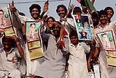 Punjab, Pakistan<br /> November 12, 1988<br /> <br /> Crowds greet Benazir Bhutto as she campaigns in the Punjab province.<br /> <br /> Benazir Bhutto is the eldest child of former Pakistan President and Prime Minister Zulfikar Ali Bhutto. She found herself placed under house arrest in the wake of her father's imprisonment and subsequent execution in 1979. In 1984 she became the leader in exile of the Pakistan Peoples Party (PPP), her father's party, though she was unable to make her political presence felt in Pakistan until after the death of General Muhammad Zia-ul-Haq. <br /> <br /> On 16 November 1988 Benazir's PPP won the largest bloc of seats in the National Assembly. Bhutto was sworn in as Prime Minister in December, at age 35 she became the first woman to head the government of a Muslim-majority state in modern times. <br /> <br /> She was removed from office 20 months later under orders of then-president Ghulam Ishaq Khan for alleged corruption. Bhutto was re-elected in 1993 but was again removed by President Farooq Leghari in 1996, on similar charges. Bhutto went into self-imposed exile in Dubai in 1998, until she returned to Pakistan on October 2007, after General Musharraf granted her amnesty and all corruption charges withdrawn.
