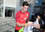 Real Madrid signing Gareth Bale signing a football shirt while leaving the St Davids Hotel in Cardiff today to head off for training with the Wales Football squad.