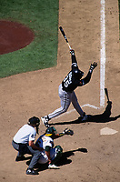 OAKLAND, CA:  Frank Thomas of the Chicago White Sox bats during a game against the Oakland Athletics at the Oakland Coliseum in Oakland, California on August 10, 1994. (Photo by Brad Mangin)