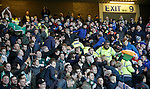 Rival fans clash as trouble spills over the narrow segregation area between Hibs and Rangers supporters at Ibrox after the opening Hibs goal on Friday night