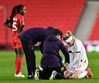 13th April 2021; Bet365 Stadium, Stoke, England; Beth Mead  of England receives medical treatment during the womens International Friendly match between England and Canada