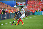Aaron Ramsey of Wales is tackled by Danny Rose of England in the second half at the Stade Bollaert-Delelis in Lens, France this afternoon during their Euro 2016 Group B fixture.