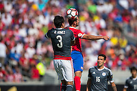 Orlando, Florida - Saturday, June 04, 2016: Paraguayan defender Gustavo Gomez (3) and Costa Rican forward Marco Urena (21) challenge for a head ball during a Group A Copa America Centenario match between Costa Rica and Paraguay at Camping World Stadium.