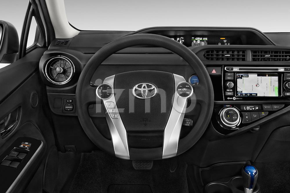 Car pictures of steering wheel view of a 2015 Toyota Prius c Three 5 Door Hatchback Steering Wheel
