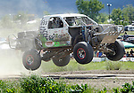 STURGIS, SD - JUNE 13: Monte Tibbitts gets air as he races in from of spectators in the pro class during the Liberty Super stores/Dakota Customs 250 short course baja race at the Buffalo Chip.  (Photo by Dick Carlson/Inertia)