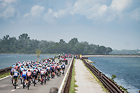 peloton leaving Grado and crossing km 0 in  the Grado Lagune only to be stopped not long after as the race was stopped and neutralized because of a big crash in the peloton.<br /> <br /> 104th Giro d'Italia 2021 (2.UWT)<br /> Stage 15 from Grado to Gorizia (147km)<br /> <br /> ©kramon