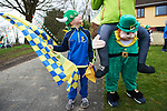 Alan Fitzpatrick eagerly awaits the start of the St Patrick's Day parade in Sixmilebridge. Photograph by John Kelly.