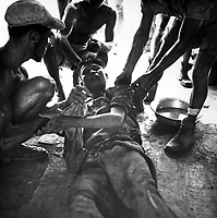 A wounded Vietminh prisoner is given first aid by Franco Vietnamese medicals after hot fire fight near Hung Yen, south of Hanoi.  Ca.  1954  (USIA)<br /> EXACT DATE SHOT UNKNOWN<br /> NARA FILE #:  306-PS-54-11793<br /> WAR & CONFLICT BOOK #:  384