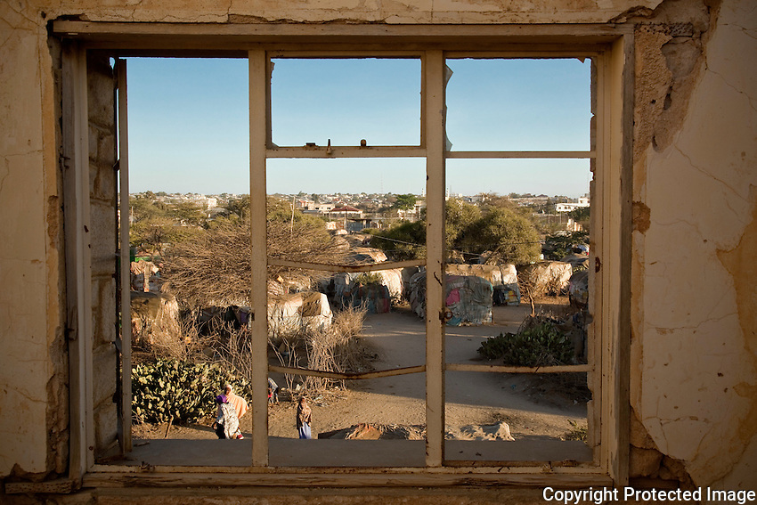 The view from the windows of State House building in Hargeysa Somaliland. The building was destroyed during Somalia's civil war. When Somalia's dictator Said Barre fell  people returned to the destroyed city of Hargeysa from refugee camps in  neigboring Ethiopia. Those with out homes  settled here in the shell of the once grand manor or in its gardens. !7 years later many stil live here. they are  joined by recent refugees from the fighting that rages daily in Mogadishu.