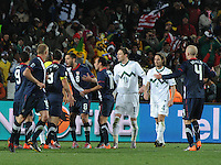 U.S. players protest the mysteriously disallowed late goal, which would have given the U.S. a 3-2, come-from-behind win. The United States came from a 2-0 halftime deficit to Slovenia to earn a 2-2 draw their second match of play in Group C of the 2010 FIFA World Cup.