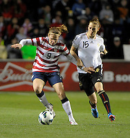 US midfielder Heather O'Reilly (9) controls the ball while being pressured by Germany's Verena Faibt (15).  The U.S. Women's National Team tied Germany 1-1 in a friendly at Toyota Park in Bridgeview, IL on October 20, 2012.
