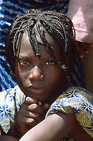 Mali. Province of Segou. Niono. October 16 2003. Worlwide food day. Young girl sweats under the midday sun during a speech by the malian president Amadou Toumani Toure (ATT). © 2003 Didier Ruef