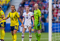 LE HAVRE,  - JUNE 20: Rose Lavelle #16 stays tight to Hedvig Lindahl #1 during a game between Sweden and USWNT at Stade Oceane on June 20, 2019 in Le Havre, France.