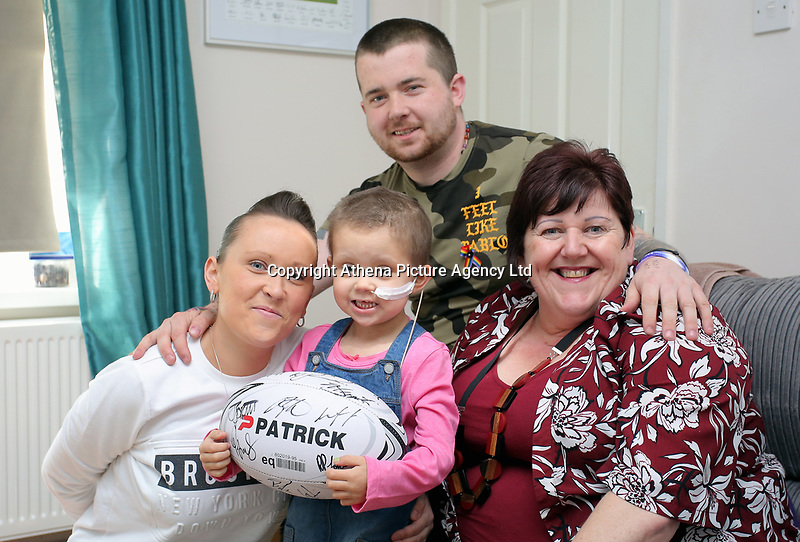 """COPY BY TOM BEDFORD<br /> Pictured: Mia Chambers (C) with dad Josh (TOP) mum Kirsty (L) and Liz James (R), the mother of rugby player Paul James, who has ben helping to fundraise.<br /> Re: One of Britain's poorest towns is raising £100,000 to send a little girl to America because the lifesaving drugs she needs are not available on the NHS.<br /> Brave Mia Chambers, five, is in remission after having an ovary and kidney removed due to neuroblastoma, a rare and aggressive type of cancer.<br /> Doctors have told her parents Josh and Kirsty there is a 50 per cent chance of the cancer returning without the specialist drugs.<br /> Josh, 28, said: """"That's not a chance we are prepared to take - the odds are too high.<br /> """"We researched it on the internet and found children in the US are beating this terrible illness.<br /> """"Doctors there are willing to treat her but it will cost more money than we have.""""<br /> The couple's plight has touched the hearts of people in their home town of Merthyr Tydfil, South Wales, and money has begun pouring in.         <br /> Mia had chemotherapy on the Rainbow ward at the Noah's Ark Children's Hospital for Wales where nurses nicknamed her the Rainbow Warrior because of her fighting spirit."""