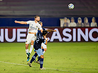 CARSON, CA - OCTOBER 18: Perry Kitchen #2  f the Los Angeles Galaxy heads a ball during a game between Vancouver Whitecaps and Los Angeles Galaxy at Dignity Heath Sports Park on October 18, 2020 in Carson, California.
