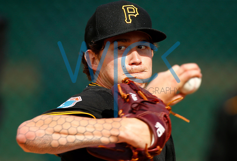 Steven Brault #65 of the Pittsburgh Pirates pitches in the bullpen during spring training at Pirate City in Bradenton, Florida on February 22, 2016. (Photo by Jared Wickerham / DKPS)