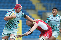 Rob Andrew of Leicester Tigers hands off Ed Williamson of London Welsh as Manusamoa Tuilagi of Leicester Tigers look on during the Aviva Premiership match between London Welsh and Leicester Tigers at the Kassam Stadium on Sunday 2nd September 2012 (Photo by Rob Munro)