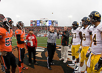 California captains' Cameron Jordan, Mike Mohamed, Chris Guarnero, and Kevin Riley and Oregon State captains watch referee Jay Stricherz tosses a coin before the game at Reser Stadium in Corvallis, Oregon on October 30th, 2010.   Oregon State defeated California, 35-7.