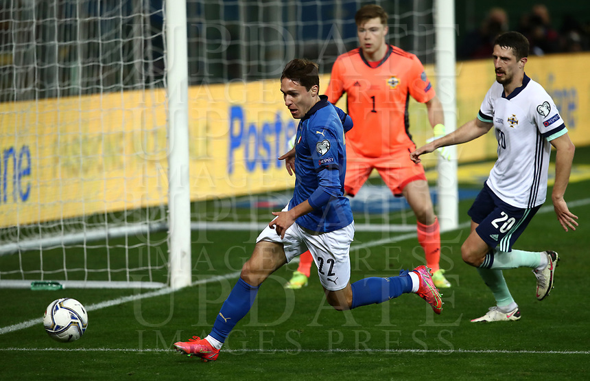 Footbal Soccer: FIFA World Cup Qatar 2022 Qualification, Italy - Northern Ireland, Ennio Tardini stadium, Parma, March 26, 2021.<br /> Italy's Federico Chiesa (L) in action with Northern Ireland's Craig Cathcart (R) during the FIFA World Cup Qatar 2022 qualification, football match between Italy and Northern Ireland, at Ennio Tardini stadium in Parma on March 26, 2021.<br /> UPDATE IMAGES PRESS/Isabella Bonotto