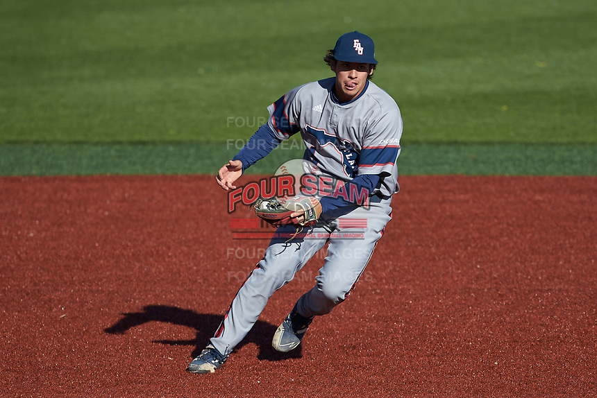 Florida Atlantic Owls shortstop Wilfredo Alvarez (4) on defense against the Charlotte 49ers at Hayes Stadium on April 2, 2021 in Charlotte, North Carolina. The 49ers defeated the Owls 9-5. (Brian Westerholt/Four Seam Images)