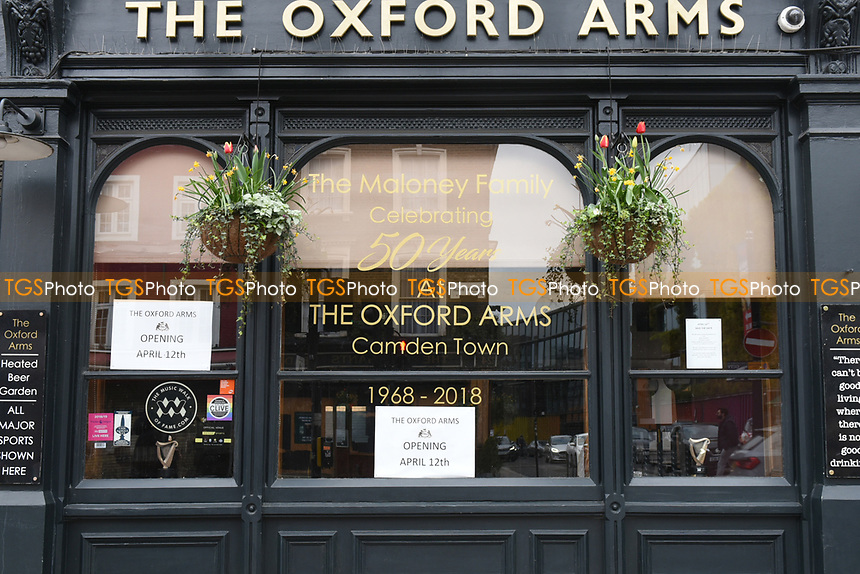 The Oxford Arms pub in Camden Town with signs in the window announcing a re-opening for outdoor drinking on April 12th as the COVID-19 lockdown restrictions start to ease across the UK on 2nd April 2021