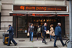 A man walks out with a takeout order from Num Pang Sandwich Shop, located at 1129 Broadway during, during the busy lunch hour...There is a restaurant/bar boom happening on 26th Street between Broadway and 7th Avenue in Manhattan. About six new places have opened up in the last 8 months. This area of development is called NoMad (north of Madison Sq. Park)...Photographed on 4/23/13 by Mark Abramson for The Wall Street Journal.