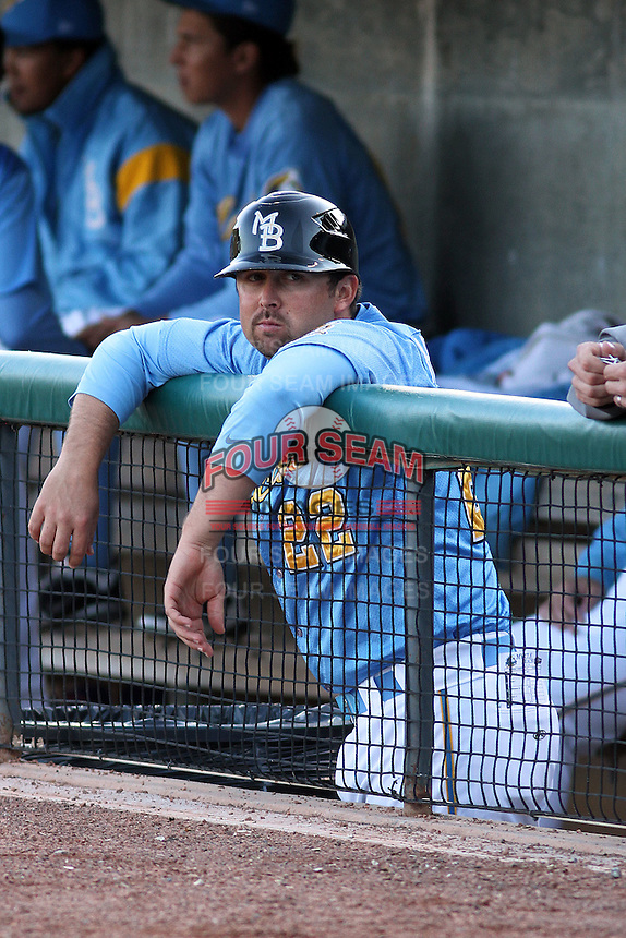 Myrtle Beach Pelicans coach Kenny Holmberg #22 in the dugout during a game against the Frederick Keys at Tickerreturn.com Field at Pelicans Ballpark on April 24, 2012 in Myrtle Beach, South Carolina. Frederick defeated Myrtle Beach by the score of 8-3. (Robert Gurganus/Four Seam Images)