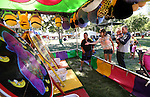 Jack Flansberg, Alicia Dilegame and Penelpe Dilegame, 1, play carnival games at the NV150 Fair at Fuji Park, in Carson City, Nev., on Friday, Aug. 1, 2014.<br /> Photo by Cathleen Allison