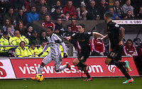 Wednesday, 01 January 2014<br /> Pictured L-R: Jonathan de Guzman of Swansea against Samir Nasri of Manchester City. <br /> Re: Barclay's Premier League, Swansea City FC v Manchester City at the Liberty Stadium, south Wales.