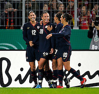 Abby Wambach celebrates with teammates after her goal. US Women's National Team defeated Germany 1-0 at Impuls Arena in Augsburg, Germany on October 27, 2009.