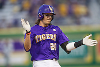 LSU Tigers third baseman Conner Hale (20) claps his hands as he arrives at third base during a Southeastern Conference baseball game against the Texas A&M Aggies on April 24, 2015 at Alex Box Stadium in Baton Rouge, Louisiana. LSU defeated Texas A&M 9-6. (Andrew Woolley/Four Seam Images)