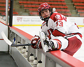 Colin Blackwell (Harvard - 63) stretches during warmups. - The Harvard University Crimson defeated the visiting Yale University Bulldogs 8-2 in the third game of their ECAC Quarterfinal matchup on Sunday, March 11, 2012, at Bright Hockey Center in Cambridge, Massachusetts.