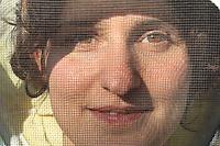 Stephanie Rack, 28 years old, Thônes in Haute-Savoie, posing in the apiary. Great regularity is demanded in managing the production of royal jelly. It's a much less physical job than the production of honey and I can live my life as a young woman in my spare time. I have two productions in the week. A 6-day week. ///Stéphanie Rack, 28 ans, Thônes en Haute-Savoie. Pose au rucher. La production de gelée royale demande une très grande régularité dans la gestion de la production. C'est un métier moins physique que la production de miel et je peux vivre ma vie de jeune femme avec du temps libre. J'ai deux production dans le semaine. Une semaine de 6 jours.