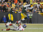 Green Bay Packers safety Nick Collins, right, just misses an interception as he and teammate Sam Shields defend New York Giants receiver Mario Manningham during the second quarter of the game at Lambeau Field in Green Bay, Wis., on Dec. 26, 2010.