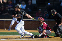 Stuart Fairchild (4) of the Wake Forest Demon Deacons follows through on his swing against the Florida State Seminoles at David F. Couch Ballpark on April 16, 2016 in Winston-Salem, North Carolina.  The Seminoles defeated the Demon Deacons 13-8.  (Brian Westerholt/Four Seam Images)
