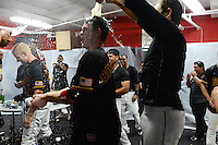Rochester Red Wings infielder James Beresford (2) gets doused by a teammate as the team celebrates in the locker room after defeating the Scranton Wilkes Barre RailRiders on September 2, 2013 at Frontier Field in Rochester, New York to clinch the International League Wild Card Playoff spot.  (Mike Janes/Four Seam Images)