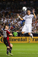 Pepe (3) of Real Madrid heads the ball as Antonio Cassano (99) of A. C. Milan looks on. Real Madrid defeated A. C. Milan 5-1 during a 2012 Herbalife World Football Challenge match at Yankee Stadium in New York, NY, on August 8, 2012.