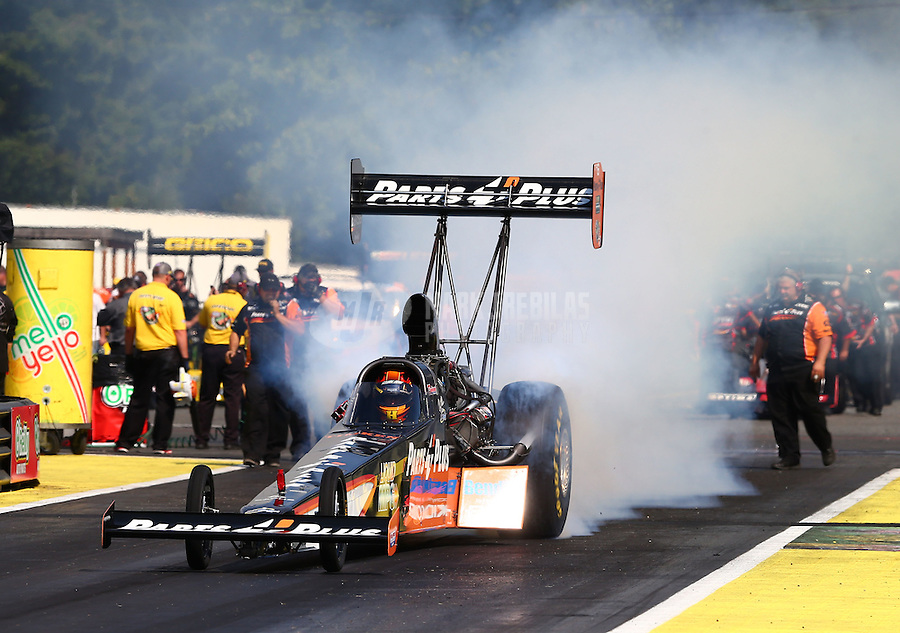 Aug. 1, 2014; Kent, WA, USA; NHRA top fuel dragster driver Clay Millican during qualifying for the Northwest Nationals at Pacific Raceways. Mandatory Credit: Mark J. Rebilas-