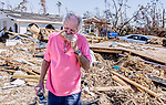 MEXICO BEACH, FL 0CT 18: Mike Danner gobbles down a quick sandwich while he waits for his wind insurance inspector in front of his damaged home  in Mexico Beach, Florida after Hurricane Michael October 18, 2018.