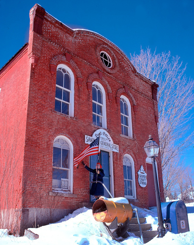 Putting up the flag at the Sandwich, New Hampshire, post office and country store. Photograph by Peter E. Randall