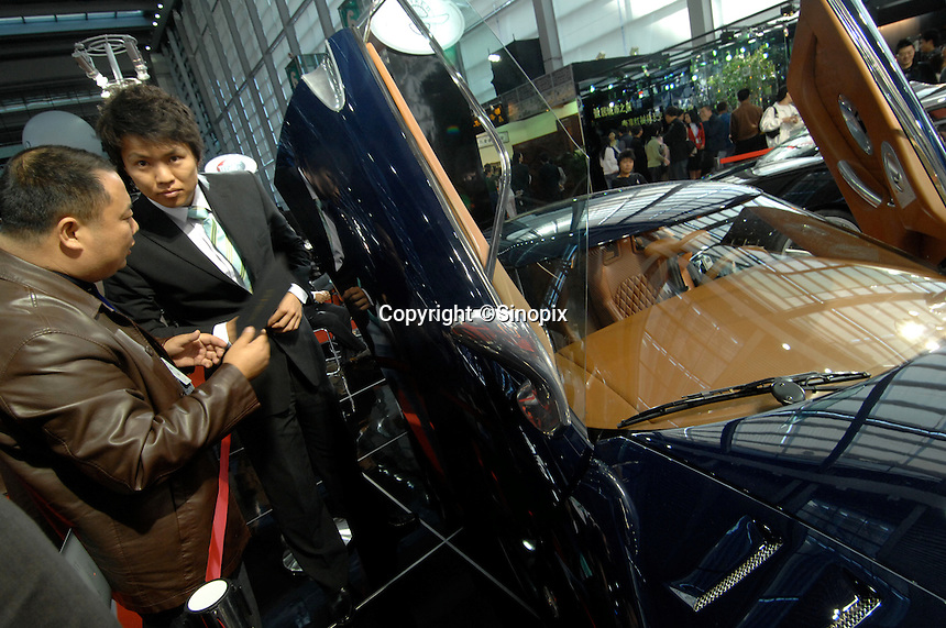 """The Spyker sports car for sale at the """"Top Show"""" luxury goods fair in Shenzhen, China."""
