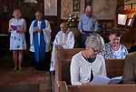 St Walstans Day, Bawburgh, St Mary and Saint Walstan's Church Norfolk 2018. Church members gather for Sunday church service and then process to the Holy healing well not far away.  <br /> <br /> St Walstan dedicated his life to farming and the care of farm animals, he is the patron saint of saint of farm workers, farmers and farm animals. He died 30 May 1016, while at work in a meadow.