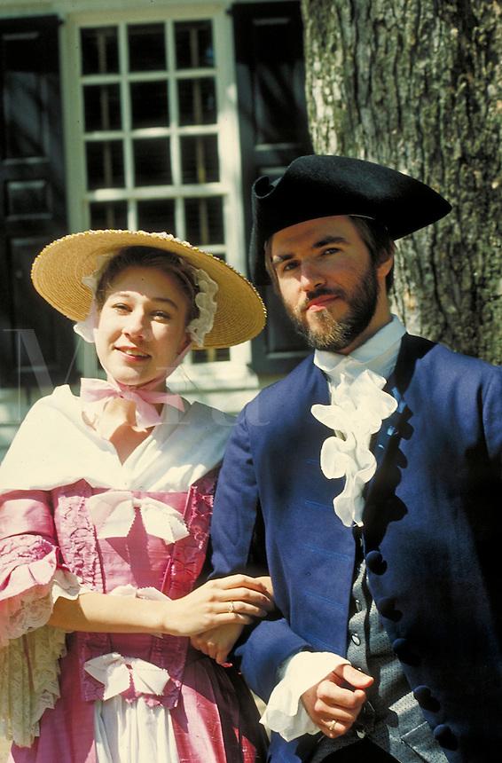 Caucasian couple in colonial period dress posing at Williamsburg historic site. white couple. Williamsburg Virginia USA.