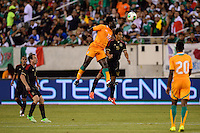 Ivory Coast forward Wilfried Bony (12) goes up for a header with Mexico midfielder Fernando Arce (16). Mexico defeated the Ivory Coast 4-1 during an international friendly at MetLife Stadium in East Rutherford, NJ, on August 14, 2013.
