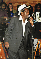 11 February 2021 - Remembering the late, reggae great, Gregory Isaacs.  Known for his sound of lovers rock mixed with roots reggae, Mr. Isaacs died of cancer in 2010. The annual Red Rose for Gregory charity event, usually held on Valentine's Day, will be postponed due to COVID-19.  File Photo: Gregory Isaacs performs on stage in 1995 at La Luna, Hamilton, Ontario, Canada. Photo Credit: Brent Perniac/AdMedia