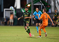 LAKE BUENA VISTA, FL - JULY 18: Eryk Williamson #30 of the Portland Timbers heads the ball away as Adam Lundkvist #3 of the Houston Dynamo looks on during a game between Houston Dynamo and Portland Timbers at ESPN Wide World of Sports on July 18, 2020 in Lake Buena Vista, Florida.