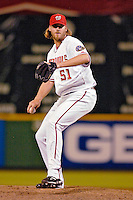 12 June 2006: Jon Rauch, pitcher for the Washington Nationals, winds up on the mound against the Colorado Rockies at RFK Stadium, in Washington, DC. The Nationals fell to the Rockies 4-3 in the first game of the four game series...Mandatory Photo Credit: Ed Wolfstein Photo..